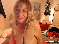 Well that was disgusting and a little bit weird. I dont know what is the story with this granny and I don't want to know all I know is that she got horny and wild and that Is all I need. First of all she took her bra off and there dropped her old and saggy titts and wait till you see what she did with her long dildo. She took her toy out and put some oil on her ass while rubbing the dildo on her big pussy lips and soon enough started jumping on it