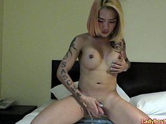 Tattooed Thai tranny Natalie shows off her pierced nipples and uncut cock during the stripping action and pees in toilet after it. Then Natalie settles herself on the bed and starts her solo jerking off session.