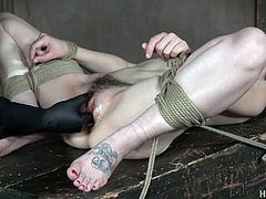 Tied up and bondage bitch Bobbi Dylan is squirting in the basement