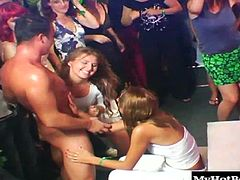 Chicks like to give dudes a hard time for going to see exotic dancers but what they do when they are out is outrageous There are no rules at this lounge, and the ladies hard up for a hard body suck off their fantasy guys cocks while the rest of the crowd looks on.