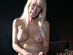 Mature Erica Lauren cherishing dick with handjob in close up