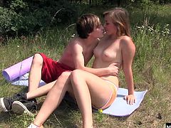 Her boyfriend slides in from behind. First he has her suck his dick after they take a detour from their bike ride and set up a towel in the grass under the beaming sun. After she rides him, he flips her over and gets some last thrusts in before jizzing all over her.