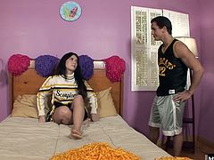 They take a moment to congratulate each other by getting naked and fucking. This long brunette haired cheerleader has a naval piercing and a completely shaved pussy that this guy fucks from behind, until she sucks his dick for a facial.