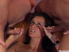 Sexy nerdy brunette in sexy lingerie stockings sucking on two big hard cocks. Gets fucked in her tight anal hard and deep as she sucks on cock. Fucking both ass and pussy with cumshot facial as the finale.