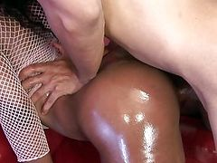 Oiled up beauty makes him cum twice, one out, one in