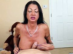 This milf doesnt want her daughters boyfriend to fuck her daughter. She decides to avoid him doing that buy stroking his cock herself until his cock is milked completely.