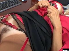 Brittany Oneil is a voluptious, blonde haired MILF who, after taking off her
