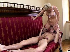 She laying back on the couch with her legs open, getting her mostly shaved, blonde pussy fingered and penetrated by her lover, who then nails her from behind before he gets a blowjob, while you see her big tits swing, until she gets a creampie.