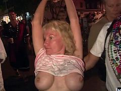 Youll see one chic whos not wearing any panties, squatting down to spread open her hairy pussy lips. Next, an older couple pauses, so the wife can show off her hooters, along with several more great knockers, that are painted.
