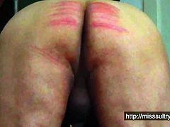 Miss Sultrybelle caning Anton.
