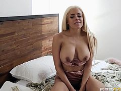 Xander is brought in and tied to a chair, having to watch the delectable Luna and Angela kiss, fondle, and eat each other out. Two hotties and a bunch of cash all over the bed make for a great sight, and he enjoys it all, especially when they get his pants off and start sucking his cock.