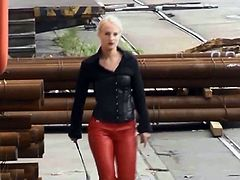 Nice Lady in red leather pants and mini skirt