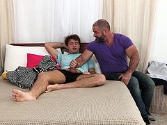 A young man takes advantage of a lazy afternoon by watching porn and jerking off. Luckily for him, his friend isn't too far away and is happy to see his horny boy touching himself. The beefy muscle daddy steps in to give the nervous, young guy a hand, teaching him not to rush the moment and just enjoy riding that edge! The young guy can't believe how good it feels to have his friend stroking him and sucking him, making him see him in a whole new light!