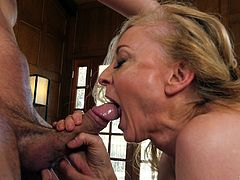 Blonde cutie Nina Hartley gets her cunt drilled on the floor