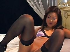 Gorgeous Lucy Lee plays with a big purple vibrator