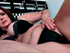 Mature brunette Andi James masturbating