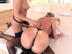 The girls take turns fucking each other with the dildos including plenty of ass stuffing, double insertion, and loud, horny moans as they pump the golden phalluses in and out of their hot, wet holes.