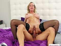 Gorgeous milf in stockings Brandi Love goes wild on a hard shlong