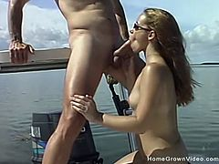Hot body brunette amateur sucking and getting her tight little pussy fucked on the boat while her older boyfriend is fishing