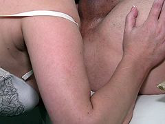 She wants to reward her husband, so this old mature lady pulls down his pants and sucks on his huge cock. She works his dick so wonderfully, until he is ready to blow his thick load all over her withered face.