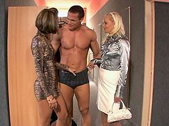 A Muscular Man Pounds Two Fully Clothed Women