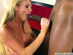 Bust blonde milf Taylor Wayne holding her legs apart to enable a long black cock go deep inside her. Moaning in delight and loving every moment as it goes in and out her sweet wet milf pussy. Gets her mouth and tits cums showered.