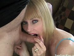 Naughty mature blonde with big tits and a glass of wine jerks then sucks two big cocks in her first homemade video
