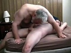 Grey old mature fat grandpa playing with a young boy