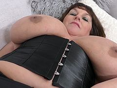 Carol is a big woman with even bigger melons. She has them out and playing with them as she moves around. Wearing black lingerie, she has her toys and her fingers to get her wet and cumming soon. What she really wants is you.
