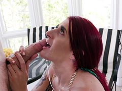 Sexy redhead Tana Lea knows how to blow a long cock properly