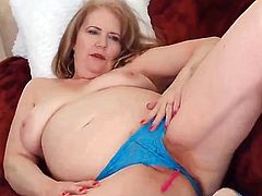 Nothing better then a horny granny and a huge toy by her side to fuck her. She starts of by taking her shirt of and revealing her old saggy tits and soon enough fingering her pussy while on her back. Then she tekes out her vibrator and started vibrating her pussy like crazy until she orgasms