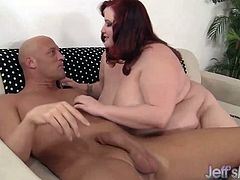 Redheaded BBW measures a dick before sucking it Then she takes it in her plump pussy and gets fucked hard and deep in many positions She takes cum in her mouth