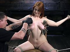 She gets wooden clothespins on her tits and, to increase the pain, her torturer starts gropping her already red and swollen boobs. Watch breathtaking bondage & enjoy brutal orgasms.