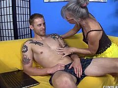The Milf notices this guy jerking off in her house again though she has warned him not to do that in her place. She gets horny to see his big dick and wants to taste his cum load.