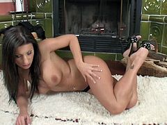 Sitting alone in front of the fireplace on a cold winter's evening, Nikki Rider feels that familiar twinge between her legs. What she needs now is a rock hard cock to slide up and down on.