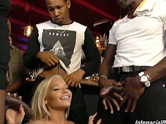Blond hottie Rachele Richey is fucked by several black dudes at the bar