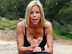 Alexis Fawx pleases a friend by jerking his hard dick outdoors