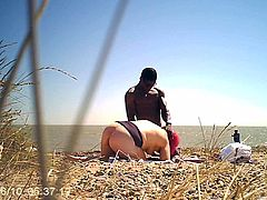 Watcing Chubby PAWG sucking big black cock on nude beach