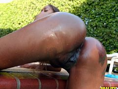After a nice swim, this thick ebony beauty was feeling very horny. She spread her legs wide and showed off her amazing pussy. She twerked that thick ass and the water splashed around her. The black beauty is having fun playing with herself, but what she really wants is a big cock in her mouth.