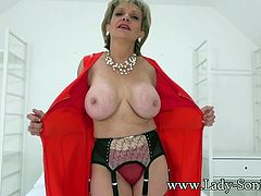 Beautiful busty blonde British milf teasing as she strips. Lady Sonia plays with her big tits and hard nipples.
