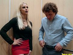 It's not always a bad thing to be trapped in an elevator, especially if you are trapped in there with a hot blonde milf like Sarah. They undress and she shows off her amazing huge boobs. Soon she is on her knees sucking cock.