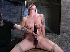Stunning blond milf Lorelei Lee gets her twat punished in the dark room