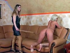Stunning blonde girl strips down to get punished with a long stick
