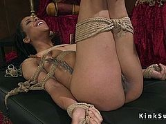 Ebony lesbian ass whipped in bondage