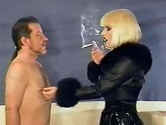 Mistress Selena Smokes with Holder