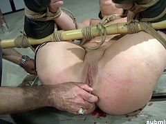 Tied hot babe gets the double dildo punishment she deserves