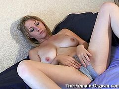 Natural breasted Ayla masturbates her big pussy lips and gets a wet spot in her panties before buzzing her clit directly with a pocket rocket until she has a nice orgasm with strong contractions.