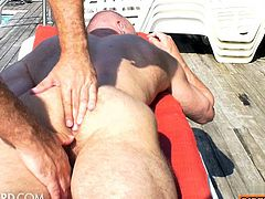 Hairy bodybuilder outdoor with massage