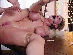 This sexy milf with huge tits adores when his hard cock drills her tight asshole, as she is out of her mind with how great she feels. With rough bdsm, rope bondage, hard fucking and with a ball gag in her mouth, Dee Williams tests her sexual limits