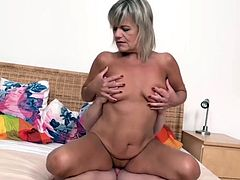 blonde granny on the bed